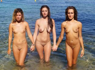 Several maiden nudists posing naked on the Mediterranean..